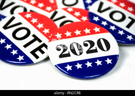 close up of political voting pins for 2020 election on white - Stock Photo