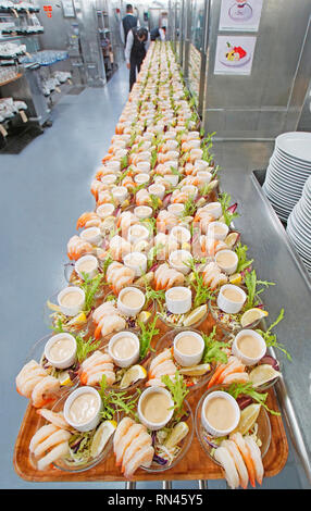 Shrimp cocktail starters being prepared in galley for Main Dining Room dinners on Holland America's cruise ship m/s Westerdam. - Stock Photo