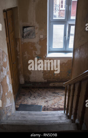 Crumbling interior of apartment building in Warsaw Ghetto tenement house - Stock Photo