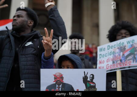 Trafalgar Square, London, UK. 16th Feb 2019. Photograph taken in central London during a protest organised by the Sudanese population in the UK in order to overthrow the Sudanese regime which has reigned for about 30 years causing civil upheaval and genocides mostly in the South Sudan which now holds its independence. The county overall has suffered from justice ranging from hyperinflation to unlawful imprisonment. Credit: Ioannis Toutoungi/Alamy Live News - Stock Photo