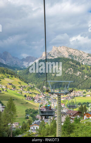 Chairlifts down to Santa Cristina in fall gardena, Italy - Stock Photo