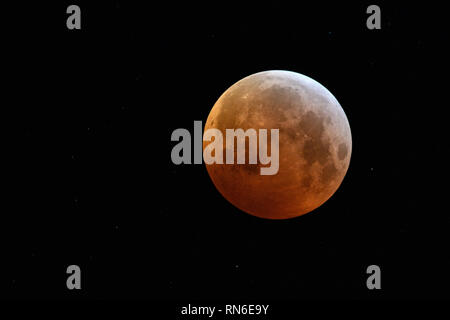 Eclipse of the super moon, lunar eclipse, red supermoon, blood moon / Blutmond, red orange full moon with sparkling stars on January 21, 2019, Germany - Stock Photo