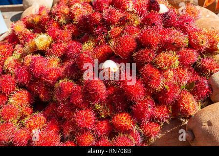 Rambutan, Nephelium Lappaceum, exotic fruits at tlacolula market, oaxaca, mexico - Stock Photo