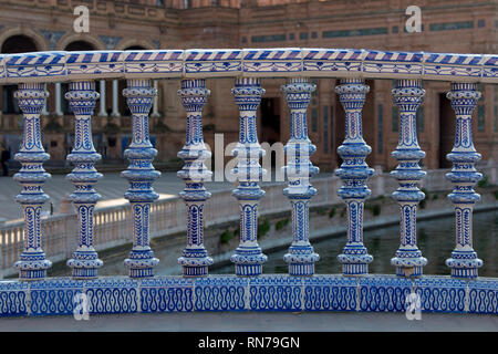 Repeated ceramic pillars of the plaza de Espana in Seville - Stock Photo
