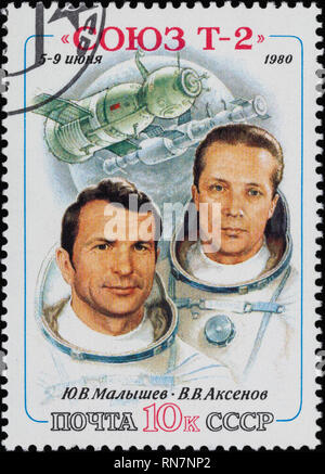 RUSSIA - CIRCA 1980: A postage stamp printed in Russia, shows portraits of cosmonauts Malyshev and Aksenov and spaceship Soyuz T-2, circa 1980. - Stock Photo