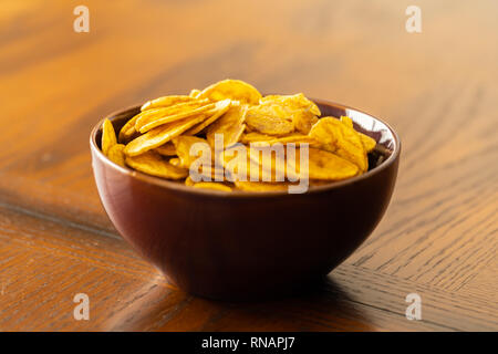 Nigerian Plantain Chips in Bowl ready to Eat - Stock Photo