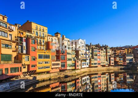 Multi-coloured houses along the River Onyar near Gomez brdge in Girona, Spain - Stock Photo