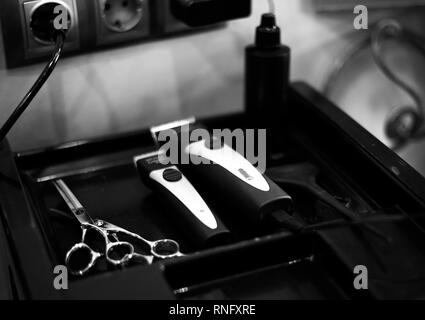 clipper and shaving machine, scissors, hairdryer, spray. beauty saloon tools for haircuts - Stock Photo