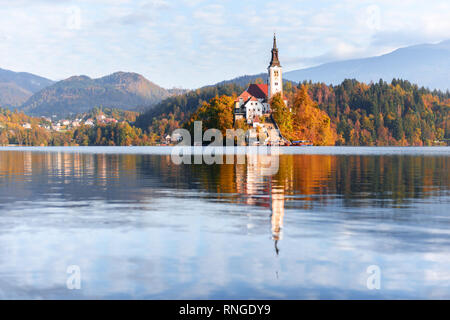 Colorful autumn view of Bled lake in Julian Alps, Slovenia. Pilgrimage church of the Assumption of Maria on a foreground. Landscape photography - Stock Photo