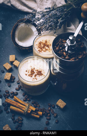 Coconut latte. Vegan coffee drink concept. Coffee with coconut milk. Health products - Stock Photo