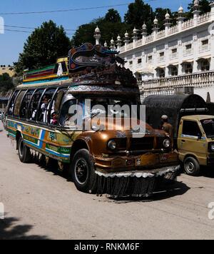 Decorated bus at the road 07 may 2015 Karakoram highway, Pakistan - Stock Photo