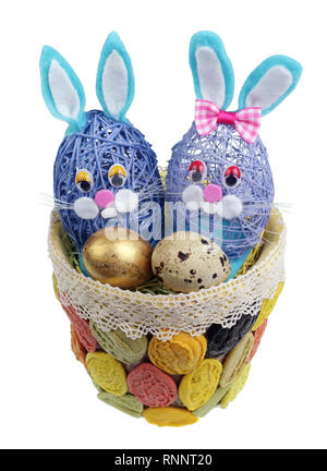 Easter handmade  nest  from  pasta with funny  bunnies and  quail egg. Isolated on white studio macro shot - Stock Photo