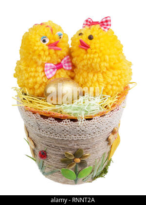 Easter handmade  nest from rope and seeds  with funny chickens and golden egg. Isolated on white studio macro shot - Stock Photo