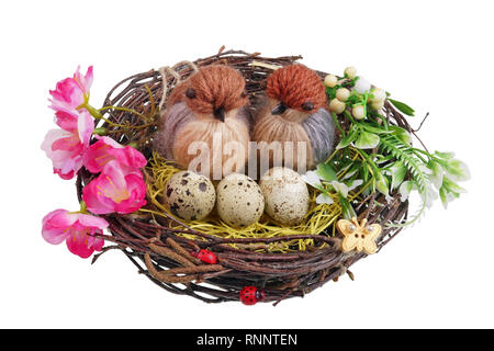 Easter handmade  nest from birch twigs  with funny birds  and eggs. Isolated on white studio macro shot - Stock Photo