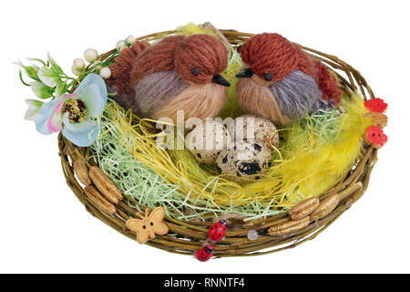 Easter handmade  nest from willow  twigs  with funny birds  and eggs. Isolated on white studio macro shot - Stock Photo