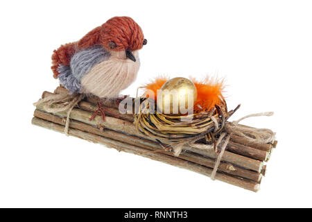 Easter handmade  nest from willow  twigs  with funny bird  and golden  egg. Isolated on white studio macro shot - Stock Photo