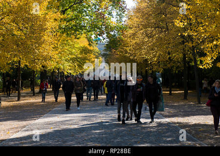 Berliners out for a nice walk in one of the urban parks, Tiergarten, during the fall when leaves are turning. In Berlin, Germany. - Stock Photo