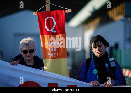 Brighton, UK. 20th Feb, 2019. Dozens of demonstrators and activists from peace and anti-arms trade organisations gather outside EDO-MBM weapons factory in Brighton in protest against Brighton and Hove City Council's planning permission to expand the factory's production of aircraft weapons release systems at its site in Brighton. Activists argue that the EDO-MBM factory has produced aircraft weapons components and sold them to several countries, included some with a bad record of human rights violations. Credit: ZUMA Press, Inc./Alamy Live News - Stock Photo
