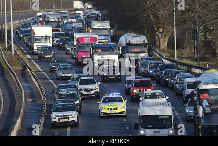 Motorists move out the way of a Sussex Police Car with its Blue lights flashing and siren sounding as it drives down the A23 near Brighton, East Sussex - Stock Photo
