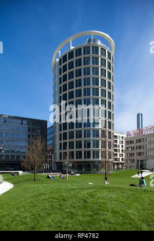 Office building 'Coffee Plaza' in the HafenCity, Hamburg with people relaxing in the park - Stock Photo