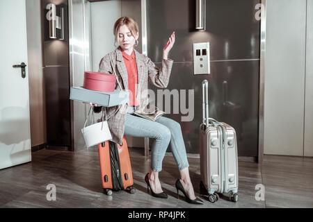 Girlfriend wearing high heels waiting for her man near elevator - Stock Photo