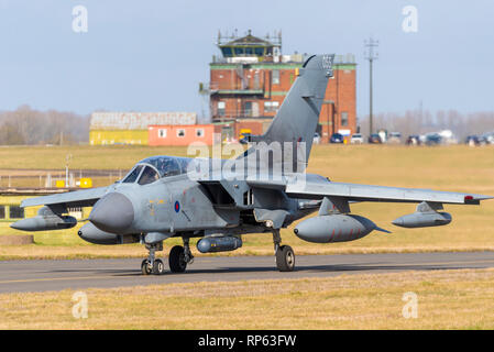 Royal Air Force Panavia Tornado Gr4 fighter jet taxiing out to take part in the RAF Tornado Farewell Tour titled FINale. With Marham Air Traffic Tower - Stock Photo