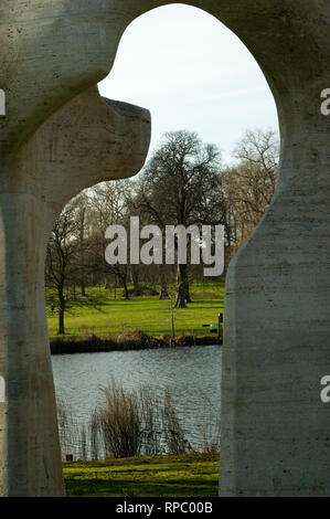 Hyde Park, London with Henry Moore Arch in foreground - Stock Photo