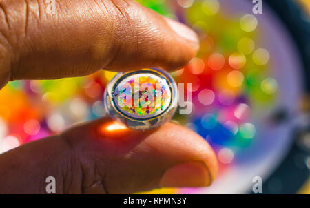 reflection of color balls in hydro gel ball. - Stock Photo