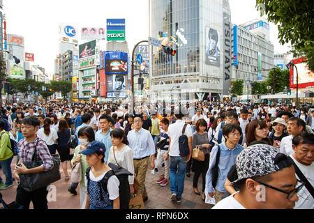 Crowds at Shibuya Crossing in Tokyo, Japan - Stock Photo