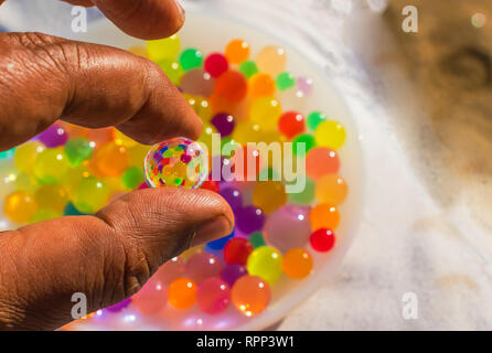 colorful balls reflection in hydrogel ball. - Stock Photo