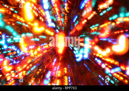 Multi-colored explosion of lights on dark background - Stock Photo