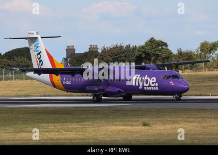 An ATR 72-500, operated by Blue Islands in FlyBE colours lands at Jersey Airport - Stock Photo