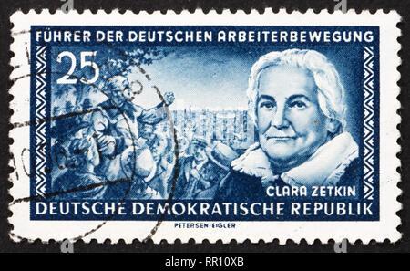 GDR - CIRCA 1955: a stamp printed in GDR shows Clara Zetkin, German Communist, circa 1955 - Stock Photo