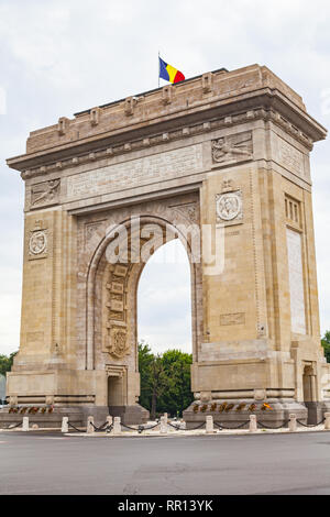 Beautiful picture of the arch of triumph with a romanian flag on it in Bucharest, capital of Romania - Stock Photo