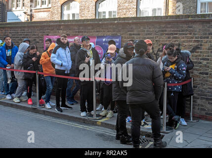 London, UK, 23 February 2019, Hundreds queue at cult skateboard clothing shop Supreme in Peter street in the heart of  Soho as they launch their spring & summer range. Credit: JOHNNY ARMSTEAD/Alamy Live News - Stock Photo