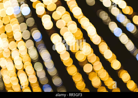 Abstract defocused bokeh illuminated garland view from below in central city square decoration for the annual Christmas Market - Strasbourg, Alsace, France - beautiful bokeh - Stock Photo