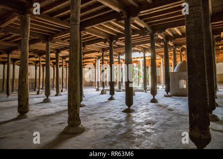 Carved wooden columns of the Juma mosque (Friday mosque) in the Khiva fortress Ichan-Kala, Uzbekistan - Stock Photo