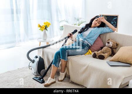 tired african american woman sleeping on sofa - Stock Photo