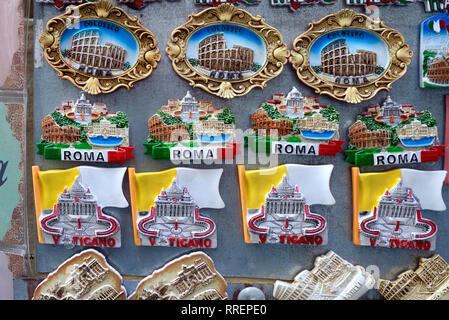 Souvenir Fridge Magnets of Roman Landmarks including the Coliseum & St Peter's Square & Basilica for Sale in Gift Shop Rome Italy - Stock Photo