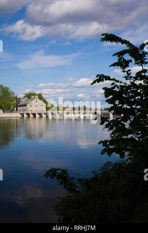 The Des Mille-Iles River and the New Mill on Ile des Moulins Historic Site in spring, Old Terrebonne, Lanaudiere, Quebec, Canada - Stock Photo