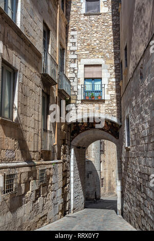 Narrow alley in the beautiful medieval town of Girona, Spain - Stock Photo