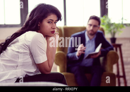 Sad unhappy young woman looking at you - Stock Photo