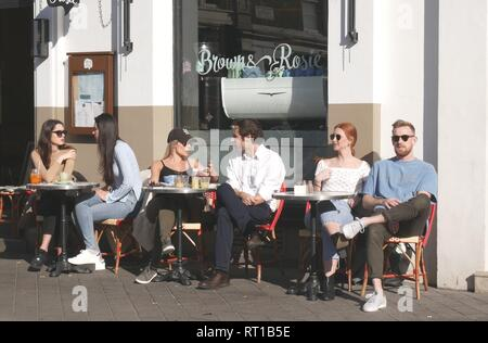 London, UK. 27th Feb, 2019. Londoners compete for al fresco tables as weather maintains record highs. Credit: Brian Minkoff /Alamy Live News - Stock Photo