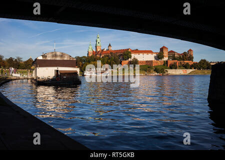 Poland, Krakow, view to Wawel Castle from under the bridge on Vistula River - Stock Photo
