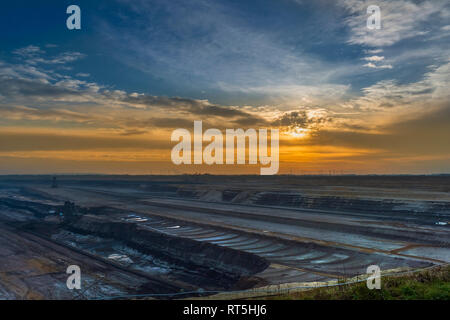 Germany, Grevenbroich, Garzweiler surface mine in winter at sunset - Stock Photo
