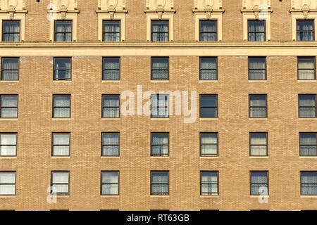 Brick facade and windows of the Rosewood Georgia Hotel in downtown Vancouver, BC, Canada - Stock Photo