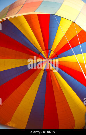 Brightly coloured view of balloon canopy in flight, Masai Mara Kenya - Stock Photo