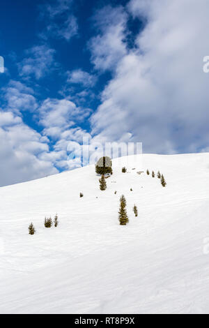 Winter landscape with blue sky and dreamy cloud formation, Ski resort See, Tyrol, Austria - Stock Photo