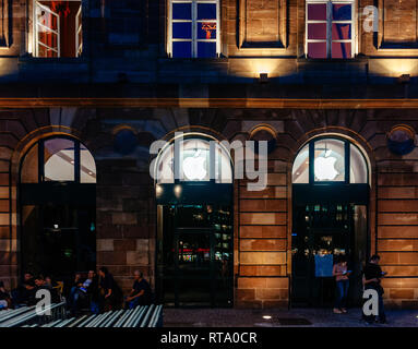 STRASBOURG, FRANCE - SEPT 18, 2014: Night view of Apple Store facade builing with impatient customers waiting in queue and tents for the upcoming Apple iPhone, Apple Watch and other new products  - Stock Photo