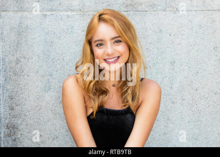 Portrait of a beautiful caucasian young adult woman outdoors in summer - Stock Photo